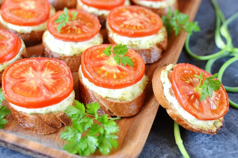 How to serve Grilled Crostini with Garlic Scape Cream Cheese and Tomatoes