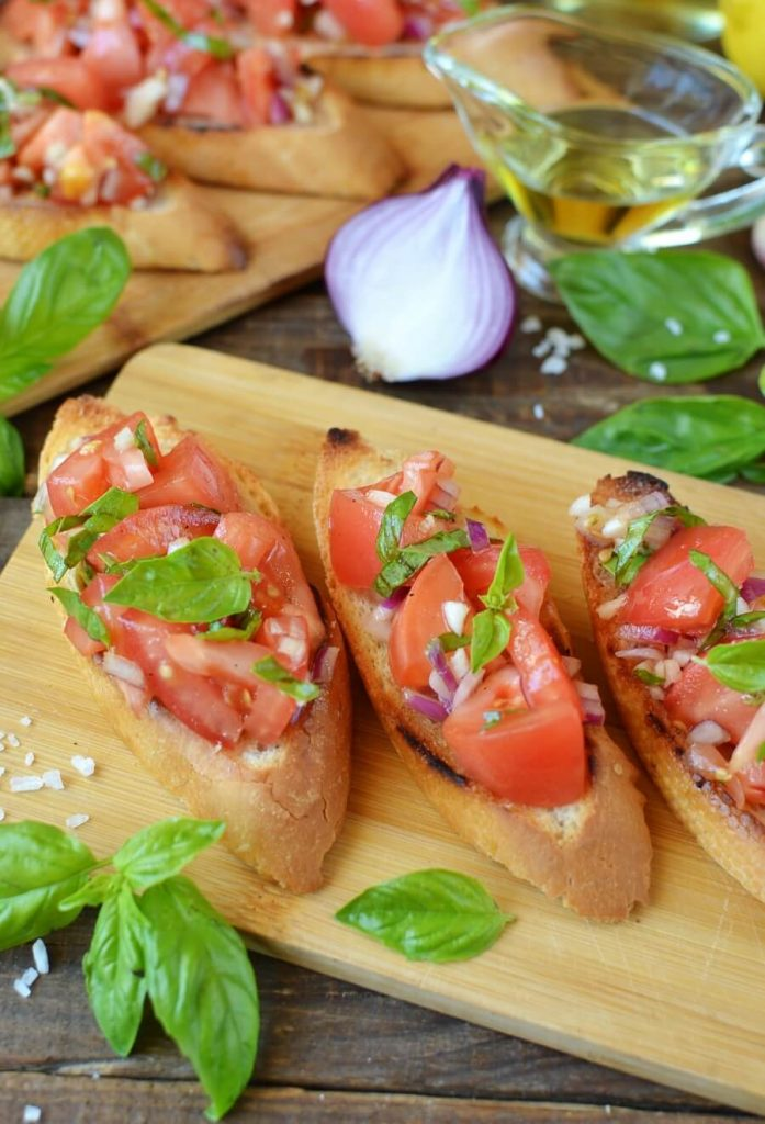Mini Toasts Topped with Tomato Salad
