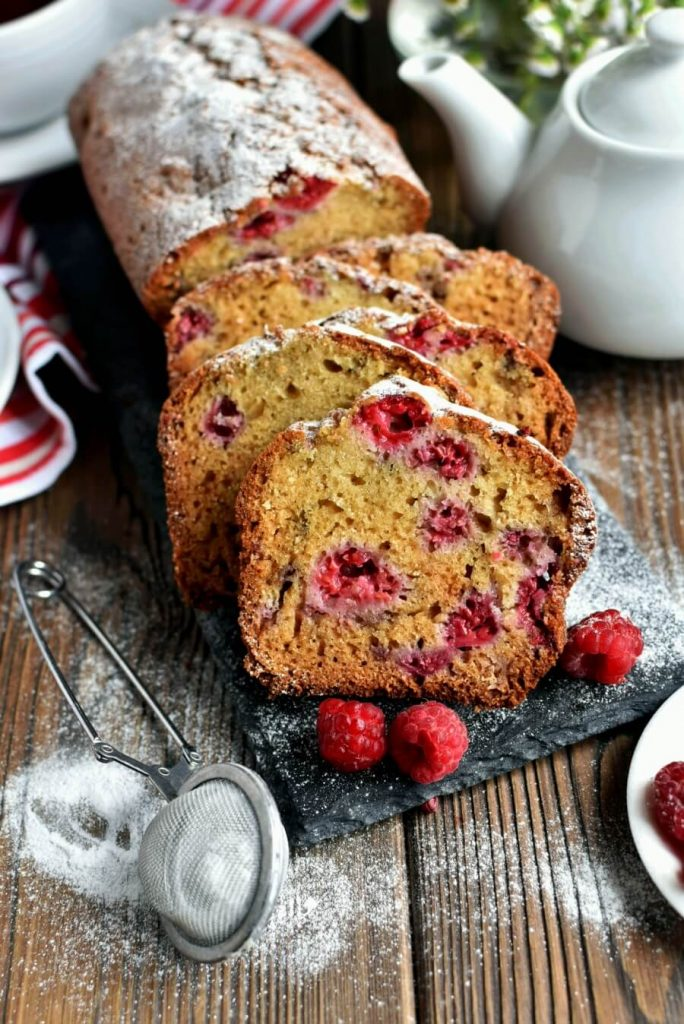 Moist loaf which is bursting with raspberries