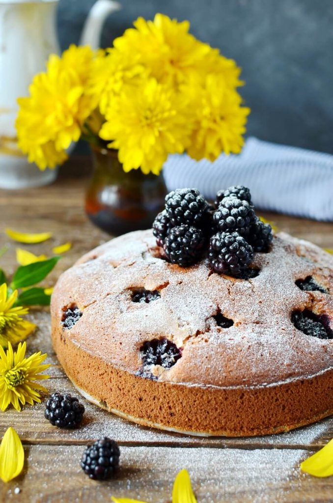 Delicious cake with layers of blackberries