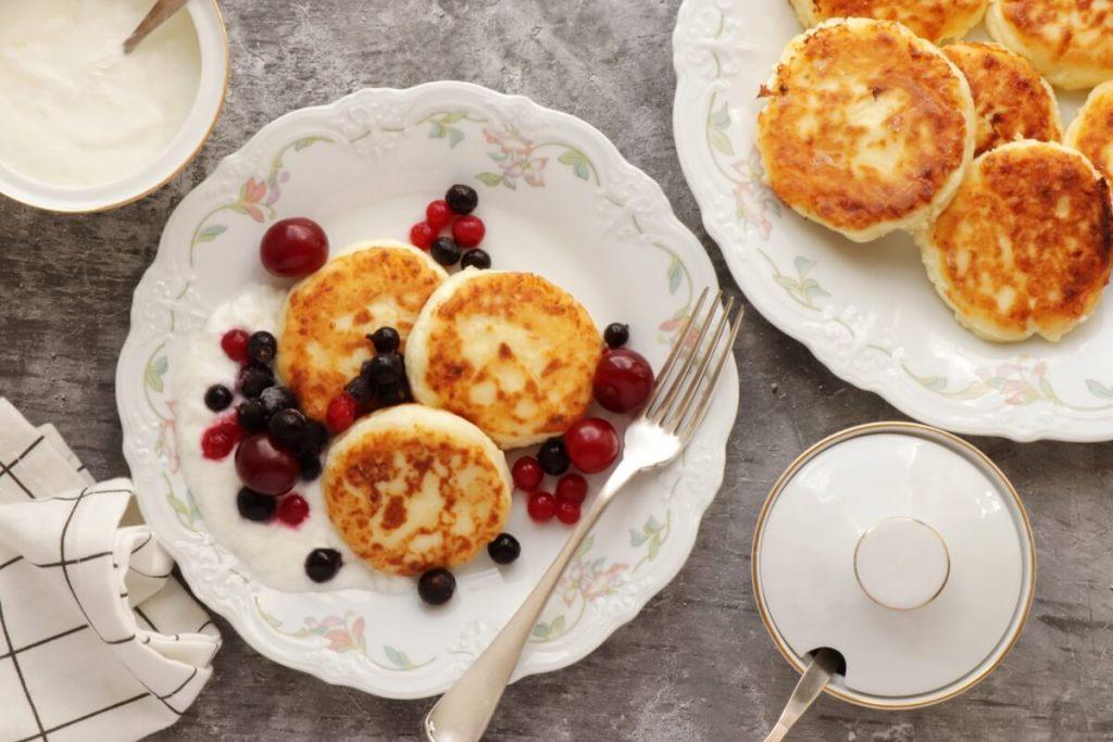 How to serve Farmer's Cheese Pancakes (Syrniki)